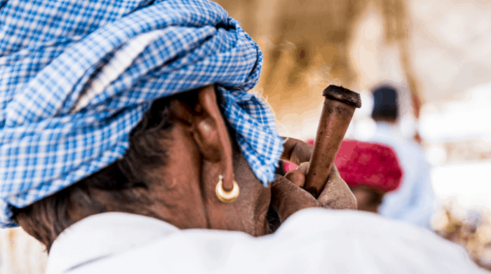 charas being smoked in a chillum