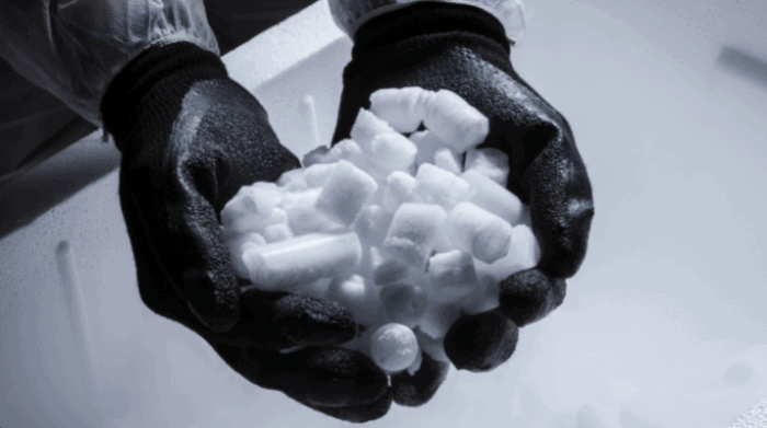 gloved hands holding dry ice